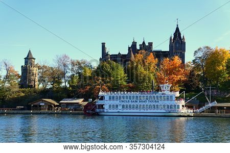 Alexandria Bay, New York, U.s.a - October 24, 2019 - The View Of Boldt Castle And Ferry Surrounded B