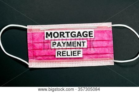 Mortgage Payment Relief Writing On Red Mask. Many Banks Worldwide Announced Mortgage And Payments Re