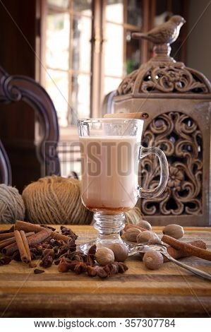 Hot Chai With Spices On Wooden Surface