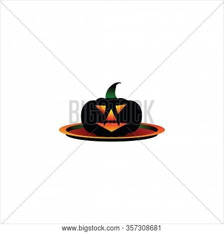 Serve The Plate With Black Pumpkin On An Empty Plate. The Concept Of Crop, Thanksgiving Dinner And H