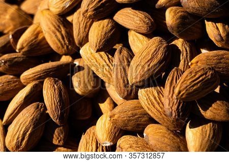 Almonds Macro. Almonds Background. Almond Nuts. Organic Texture Of Almonds. View From Above. Bright