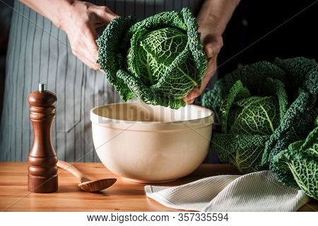 Female Hands Washing Savoy Cabbage, Organic Farming. Organic Savoy Cabbage Background. Vegan And Veg