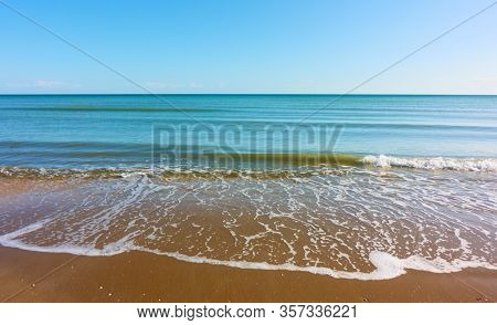 Sea and sandy beach with soft surf  - Natural ackground