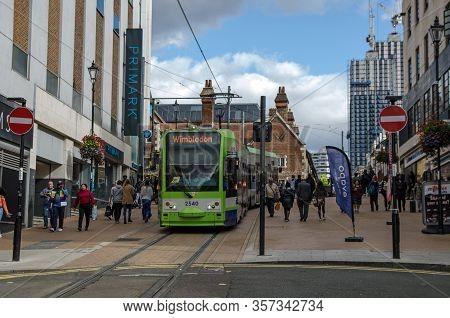 Croydon, Uk - October 2, 2019: London Transport Tram Travelling Through The Centre Of Croydon On Its