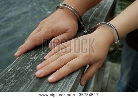 Man and Woman in Handcuffs