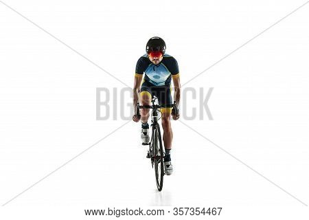 Triathlon Male Athlete Cycle Training Isolated On White Studio Background. Caucasian Fit Triathlete