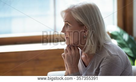 Unhappy Lonely Older Woman Sitting Alone And Thinking About Problems