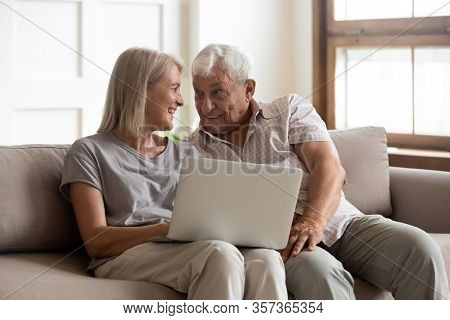 Happy Older Wife And Husband Using Laptop Together, Having Fun