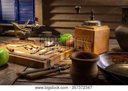 Rustic Wooden Vintage Coffee Grinder. Vintage Still Life With Antique Dishes And Green Apples. Vinta