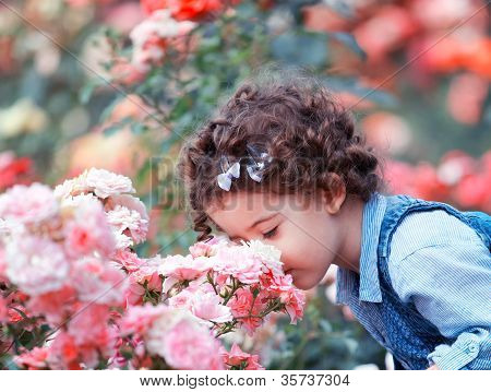 Baby Girl Smelling Pink Roses