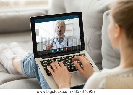 Female Patient Consult With Doctor Online Using Video Call