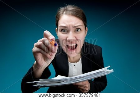 A Woman In An Office Suit With A Strict Haircut Screams Into The Camera, Pokes With A Pen And Waving
