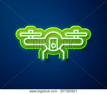 Glowing Neon Line Drone Flying Icon Isolated On Blue Background. Quadrocopter With Video And Photo C