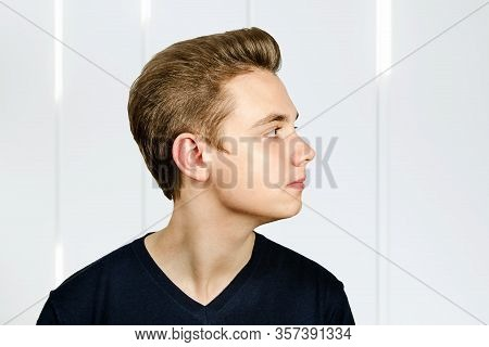 Portrait Of Young Guy With Pompadour Hairstyle. Side View.