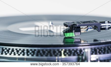 Close-up Of Modern Turntable Vinyl Record Player With Music Plate. Needle On A Vinyl Record