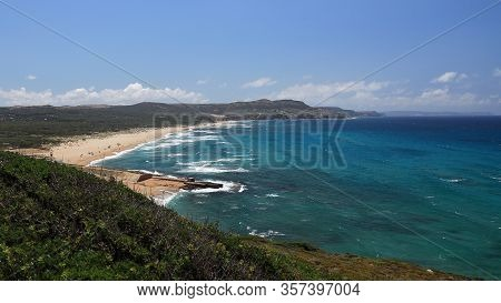 Empty Beach With Big Waves On Sunny Day In Summer