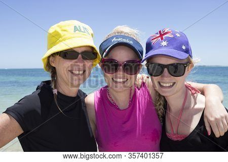 A Mother And Daughters Enjoy The Australian Summer At The Beach For Australia Day, Wearing Aussie Th