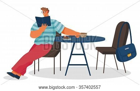 Man Reading Book In Coffeehouse. Guy Sitting On Chair By Table, Cup With Beverage And Dessert On Sur