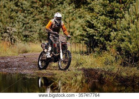Dirty Motocross Racer In Enduro Race In Forest