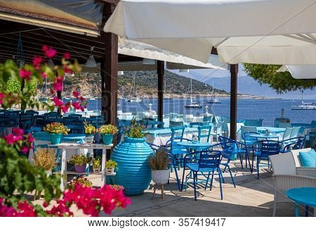 Traditional Blue And White Greek Tavern With Magnificent Sea View On A Summer Sunny Day In Kastos Is