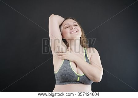 Young Happy Plus Size Caucasian Woman Shows Her Unshaved Armpit