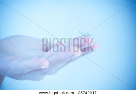 contact lens over blue background