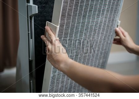 Woman Hand Open Air Purifier For Clean Dirty Air Purifier Hepa Filter.