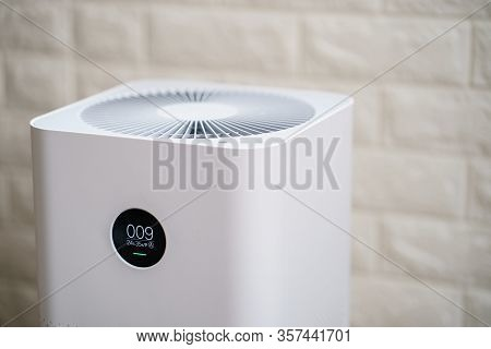 Closeup Of  Air Purifier With Monitor Screen, Show Air Quality In The Room. Pm2.5 Concept.