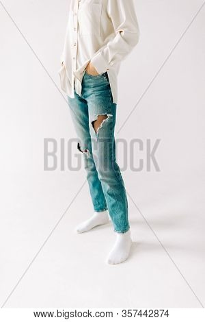 blue jeans with holes on the white background