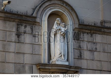 Old Sculpture With Young Woman With Child In The Arch Of The One Of Old Buildings On The La Rambla S
