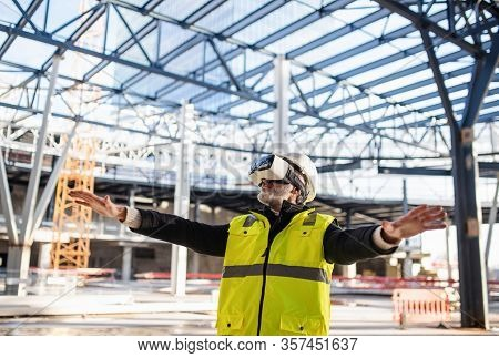 Man Engineer Using Vr Goggles On Construction Site.