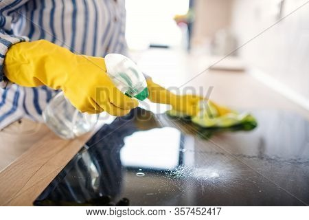 Unrecognizable Senior Woman Cleaning Kitchen Counter Indoors At Home.