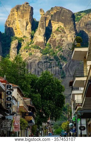 Meteora, Greece - May 9, 2016: Meteora Rocks With Famous Monasteries Seen From Streets Of Town Kalab
