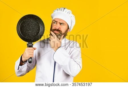 Cooking Lunch In Kitchen. My Profession. Baker With Saucepan Pot. Catering. Chef Man Holds Kitchenwa