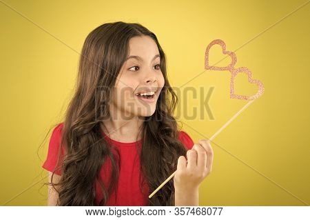 Party Shop. Valentines Day Concept. Happy Little Child Glasses Props. Funny Small Girl Holding Glass