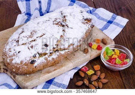 Traditional Christmas Stollen With Nuts And Candied Fruits.