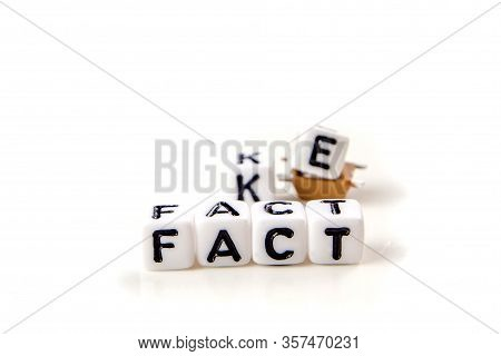 Fake And Fact Text Formed Of White Dices With Black Letters On White Background, How Can You Disting