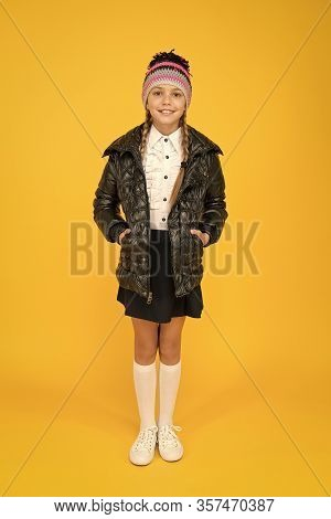 Be Stylish On Chilly Days. Stylish Schoolgirl Keep Hands In Pockets In Casual Outerwear. Little Chil