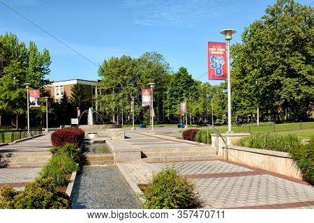 STONY BROOK, NEW YORK - 24 MAY 2015: Fountain and stream on the campus of Stony Brook University.