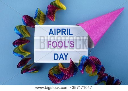 April Fools Day. Surprise Symbol. Shoelaces Tied Together On Blue Wooden Background. April Fool.