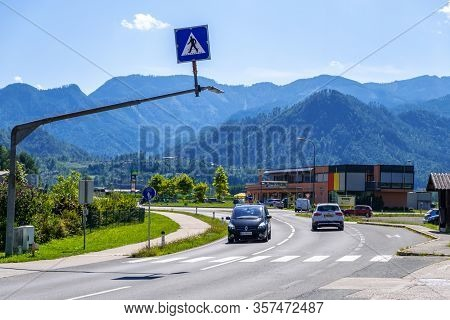 Carinthia, Austria - August 09, 2019: Road In Countryside With Alpine Hills In Carinthia, Austria