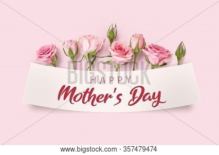 Mothers Day Greeting Card With Blossom Flowers. Rose Flowers On Pink Background. Studio Shot Of Pink