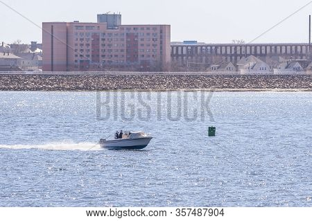 New Bedford, Massachusetts, Usa - April 6, 2019: Powerboat Zipping Across New Bedford Outer Harbor O