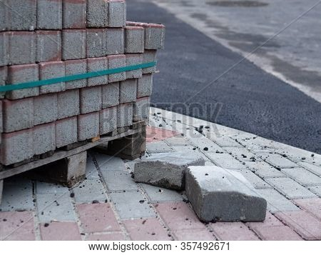 A Pile Of Paving Stone Prepared For Pavement Work Before A Street Reconstruction, Reparation.