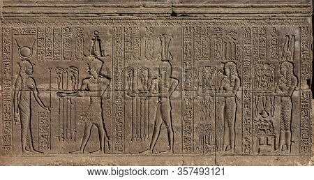 Hieroglyphic carvings on the wall of an ancient egyptian temple