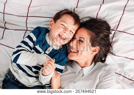 Mom Having Great Time With Her Son In Bed. Parent Kid Relationship. Mothers Day