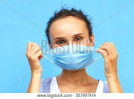A woman in a medical mask is positive. The end of the coronavirus epidemic and pandemic COVID-19