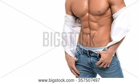 Closeup Picture Of A Male Shirtless Torso With Perfect Abs. Sexy Man It Blue Jeans And White Shirt O