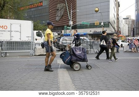 Bronx, New York/usa - May 7, 2018: Female Postal Worker Walks The Street Of Union Square East And 14
