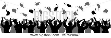 Graduation At University, College. Crowd Of Graduates In Mantles, Throws Up Square Academic Caps. Si